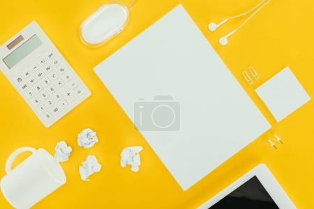 Photo for Top view of blank sheet of paper, crumpled papers, notes, calculator and computer mouse isolated on yellow - Royalty Free Image