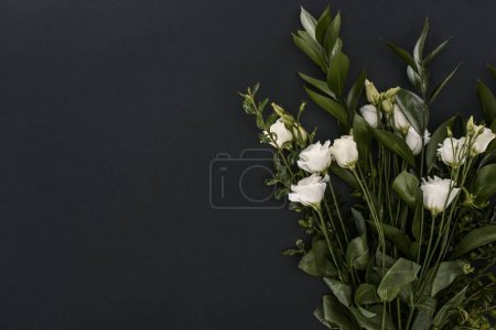 top view of bouquet with eustoma flowers over black background