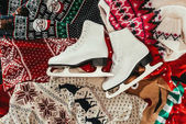 top view of pair of white skates on winter clothes