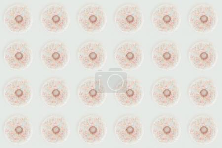 top view of white glazed doughnuts seamless pattern isolated on white