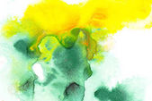 Abstract painting with green and yellow watercolor paint blots on white