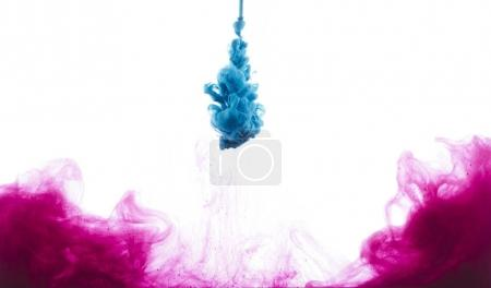 Photo for Close-up view of blue and pink paint splashes isolated on white - Royalty Free Image