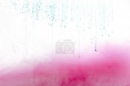 close up view of pink ink splash isolated on white