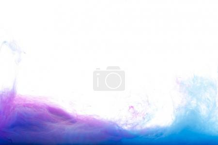 blue and purple paint in water, isolated on white