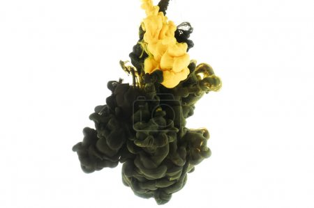 mixing of black and yellow paint splashes, isolated on white