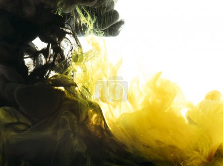 mixing of black and yellow paint, isolated on white