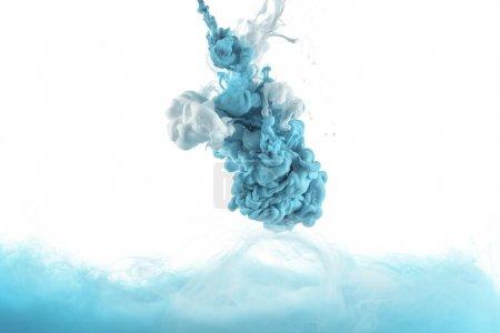 Photo for Mixing of blue paint splashes isolated on white - Royalty Free Image