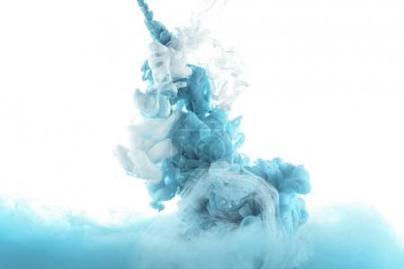 mixing of blue paint splashes isolated on white