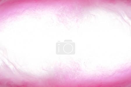 Foto de Fondo con remolinos de pintura rosa en agua - Imagen libre de derechos