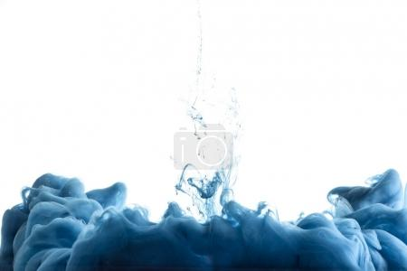 close up view of blue paint splash in water, isolated on white with copy space