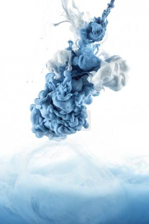 Photo for Close up view of mixing of blue and white paint splashes isolated on white - Royalty Free Image