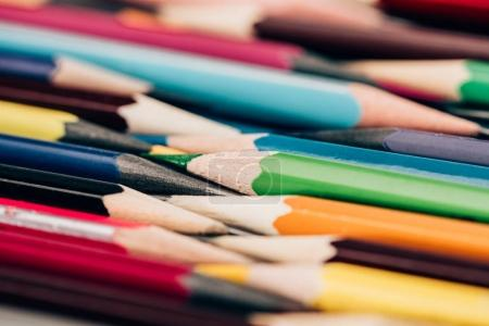 Close-up view of colorful pencils in mess as educational background