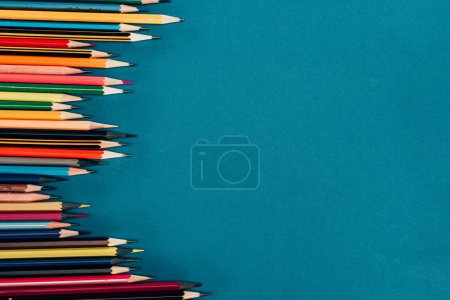 Photo for Top view of composition of colorful pencils isolated on blue background - Royalty Free Image