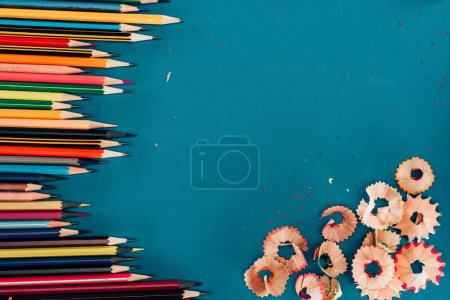 Photo for Top view of composition of colorful pencils and cuttings isolated on blue background - Royalty Free Image