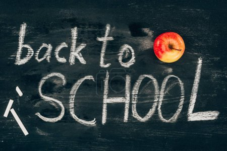 Back to school inscription on chalk board with apple