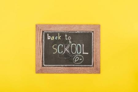Top view of Back to school inscription with mistake on chalk board