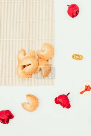 top view of chinese fortune cookies and flowers isolated on white, Chinese New Year concept