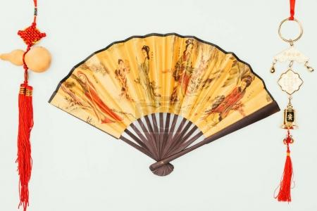 top view of chinese handheld fan with talismans isolated on white
