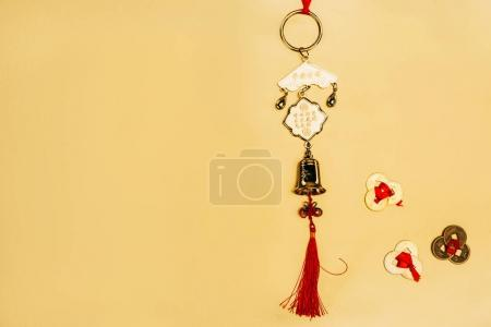 top view of traditional chinese talisman with coins on yellow, Chinese New Year concept