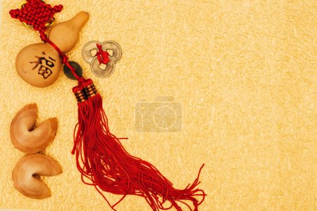 top view of chinese talismans with fortune cookies on golden surface, Chinese New Year concept