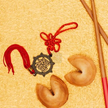 top view of chinese talisman and fortune cookies on golden surface, Chinese New Year concept