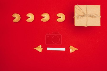 top view of chinese fortune cookies with one opened and handmade giftbox, Chinese New Year concept