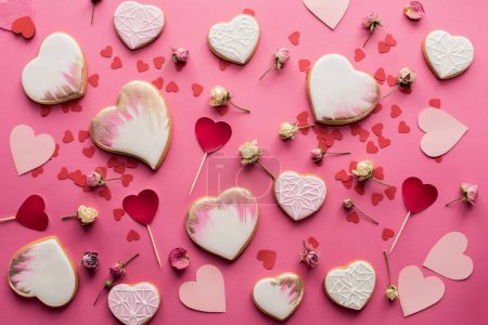 Photo for Flat lay with heart shaped cookies, decorative flowers and paper hearts isolated on pink, st valentines day concept - Royalty Free Image