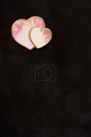top view of heart shaped cookies on dark surface
