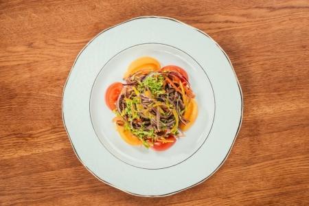 fresh vegetables sliced on white plate over wooden surface