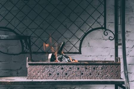 grill with fire, flames and charcoals indoors