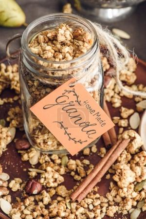 overhead view of homemade granola in glass jar with tag