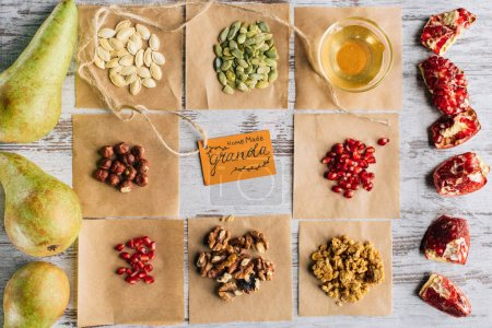 Photo for Top view of granola ingredients and tag on wooden table - Royalty Free Image