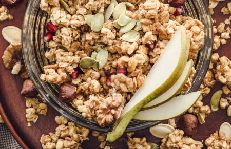 top view of homemade granola with pear and pumpkin seeds