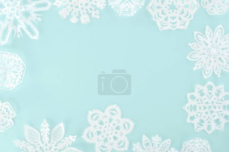 christmas frame with decorative snowflakes, isolated on light blue