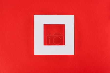 Photo for White frame isolated on red with copy space - Royalty Free Image
