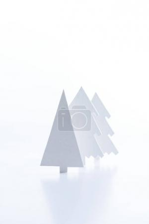 white paper christmas trees, isolated on white