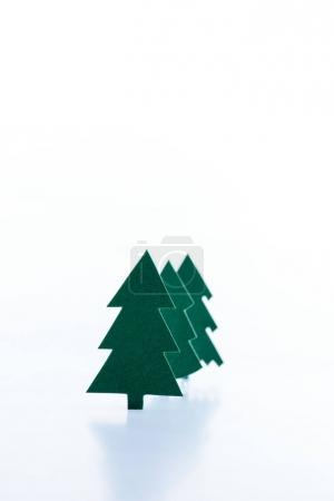 green paper christmas trees, isolated on white