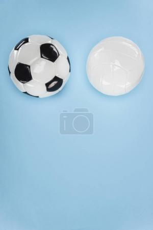 Balls for soccer and volleyball isolated on blue