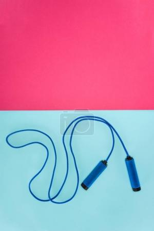 Skipping rope isolated on pink and blue