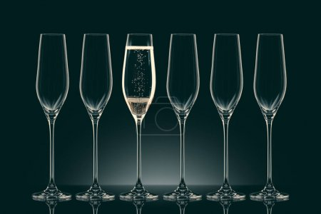 five empty glasses and one glass with champagne on black