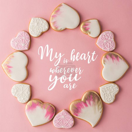 Photo for Flat lay with arrangement of glazed heart shaped cookies isolated on pink surface - Royalty Free Image