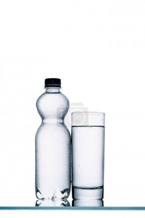 Photo for Still life with wet plastic bottle of water and glass isolated on white - Royalty Free Image