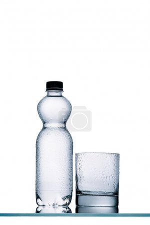 plastic bottle of water and empty glass isolated on white