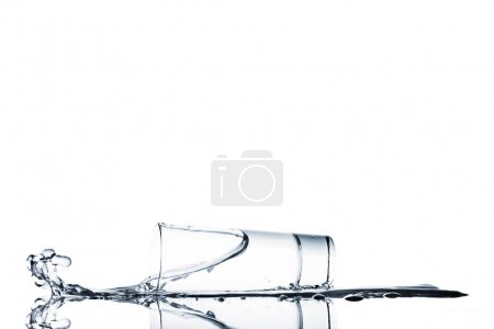 Photo for View of water spilling from glass isolated on white - Royalty Free Image