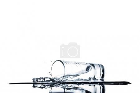 fresh water spilling from glass isolated on white