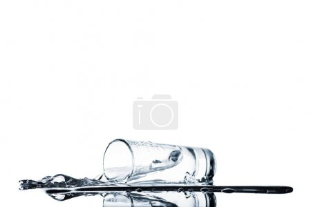 clean water spilling from glass isolated on white