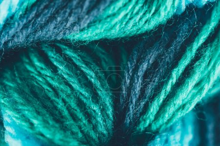 close up view of blue and green knitting yarn ball