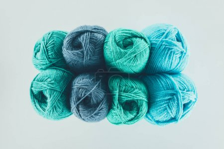 top view of blue and green knitting yarn balls, isolated on white