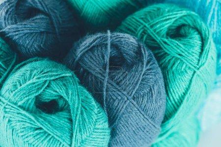 close up of blue and green knitting yarn balls