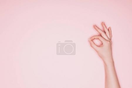 Photo for Cropped shot of woman showing okay sign isolated on pink - Royalty Free Image